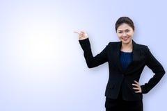 Asiatischer Geschäftsfraupunkt oben lizenzfreie stockfotos