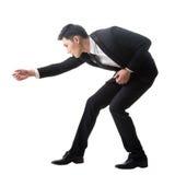 Asiatischer Geschäftsmann, der Tauziehen aufwirft Lizenzfreies Stockbild