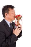 Asiatischer Geschäftsmann in küssender goldener Trophäe der Klage Lizenzfreie Stockfotos
