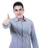 Asiatischer Geschäftsmann, der sich Daumen zeigt Lizenzfreies Stockfoto
