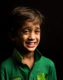 Asiatischer Junge lokalisiert auf Schwarzem Lizenzfreies Stockbild