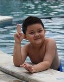 Asiatischer kleiner Junge in der Aktion, im November 2014 Stockbilder