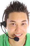 Asiatischer Mann auf Kopfhörer Stockfotos