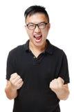 Asiatischer Mann, der aufgeregt glaubt Stockfotos