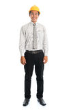 Asiatischer Mann des vollen Körpers, der gelben Hardhat trägt Stockbilder