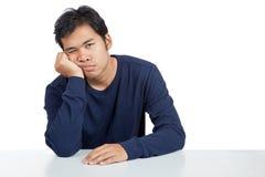 Asiatischer Mann gebohrt Stockfotografie