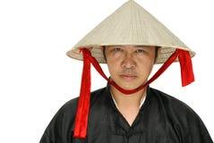 Asiatischer Mann mit Vietnam-Hut Stockbilder