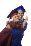 Asiatischer Mann und blonde Frauenabsolvent Lizenzfreie Stockfotografie