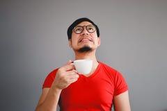 Asiatischer Mann und Kaffeetasse Stockfotos