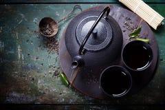 Asiatischer Teesatz des schwarzen Eisens lizenzfreies stockbild