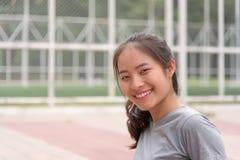 Asiatischer weiblicher Athlet, der gute Haut hat Stockbilder