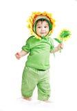 Asiatisches Baby in einem Abendkleid der Sonnenblume Stockbild