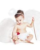 Asiatisches Baby in einem Abendkleid des Engels Stockbild