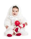 Asiatisches Baby in einem Abendkleid des Kaninchens Stockfoto