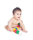 Asiatisches Baby mit einem Spielzeug Stockbild