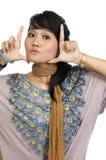 Asiatisches Baumuster, das ihr Gesicht gestaltet Stockfotos