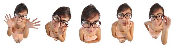 Asiatisches chinesisches Mädchen, das lustige Puppegesichter 2 bildet Stockfotos
