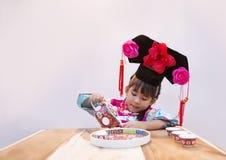 Asiatisches chiness Reihenkostüm in der Aktion lizenzfreie stockbilder