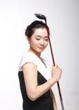 Asiatisches Frauengolf spielen stockbilder