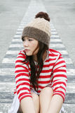 Asiatisches Mädchen, das weg schaut Lizenzfreie Stockbilder