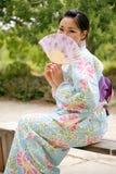 Asiatisches Mädchen in einem Komona lizenzfreies stockfoto