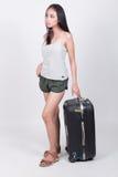 Asiatisches Mädchen im Reisekonzept lizenzfreies stockbild