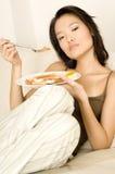 Asiatisk ätafrukost royaltyfria bilder