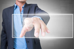 Asiatisk affärsman med pekskärmen Arkivbilder