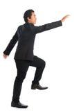 Asiatisk affärsmanhand för full kropp som griper något Arkivfoto