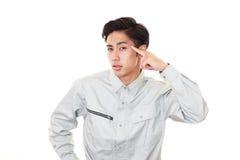Asiatisk arbetare i en orolig blick royaltyfria foton