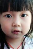 asiatisk barnframsida Arkivbild