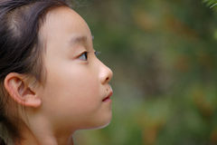 asiatisk barnframsida royaltyfria bilder