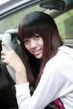 asiatisk bilflicka henne Arkivbild