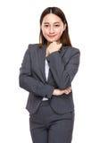 Asiatisk blandad affärskvinnastående Arkivfoto