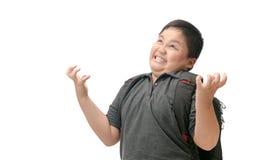 Asiatisk borrad pojkestudentkänsel och isolerat stressat fotografering för bildbyråer