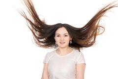 Asiatisk brunettflicka med långt hår Royaltyfria Foton