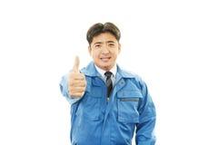 Asiatisk byggnadsarbetare royaltyfria bilder