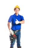 Asiatisk byggnadsarbetare med hjälpmedel Arkivbilder