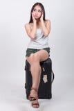 Asiatisk flicka i loppbegrepp Fotografering för Bildbyråer