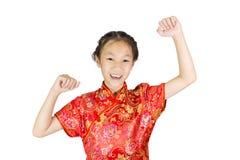 Asiatisk flicka som bär den röda kinesiska dräkten Arkivbild