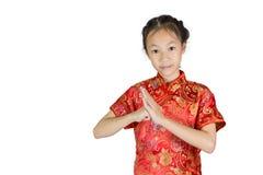 Asiatisk flicka som bär den röda kinesiska dräkten Arkivbilder