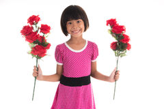 asiatisk flicka som rymmer en ros Fotografering för Bildbyråer