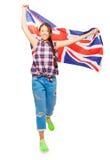 Asiatisk flicka som vinkar den brittiska flaggan som isoleras på vit Arkivbild