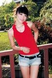asiatisk flicka utomhus Arkivbild