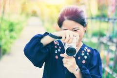 asiatisk flickafotograf Royaltyfri Bild