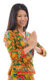Asiatisk flickahälsning för Southeast Arkivfoto
