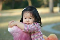 asiatisk gullig litet barn Arkivbild