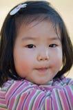 asiatisk gullig litet barn Arkivfoto