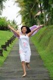 asiatisk härlig running kvinna Arkivfoto