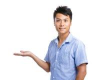 Asiatisk handshow för ung man Royaltyfri Foto